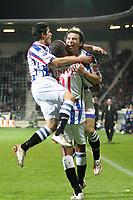den haag, 09-11-2008, ado - heerenveen<br /> bonaventura kalou (m) viert zijn 0-1 doelpunt met tarik elyounoussi (l) en danijel pranjic (r)