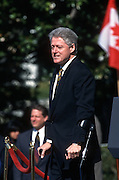 President Bill Clinton with crutches during the arrival ceremony for visiting Canadian Prime Minister Jean Chrétien April 8, 1997 on the South Lawn of the White House.