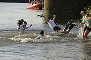 """Putney/Mortlake, GREATER LONDON. United Kingdom. 2017 Women's and Men's University Boat Races, held over, The Championship Course, Putney to Mortlake on the River Thames. selection of coxes being """"thrown in""""  Sunday  02/04/2017, <br /> <br /> [Mandatory Credit; Intersport Images]"""