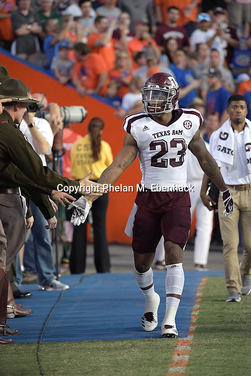Texas A&M defensive back Armani Watts (23) walks onto the field before an NCAA college football game against Florida Saturday, Oct. 14, 2017, in Gainesville, Fla. (Photo by Phelan M. Ebenhack)