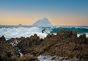 A surfer ploughs through the waves at St. Finan's Bay in County Kerry with The Skellig Rocks in the background.<br /> Photo Don MacMonagle-macmonagle.com