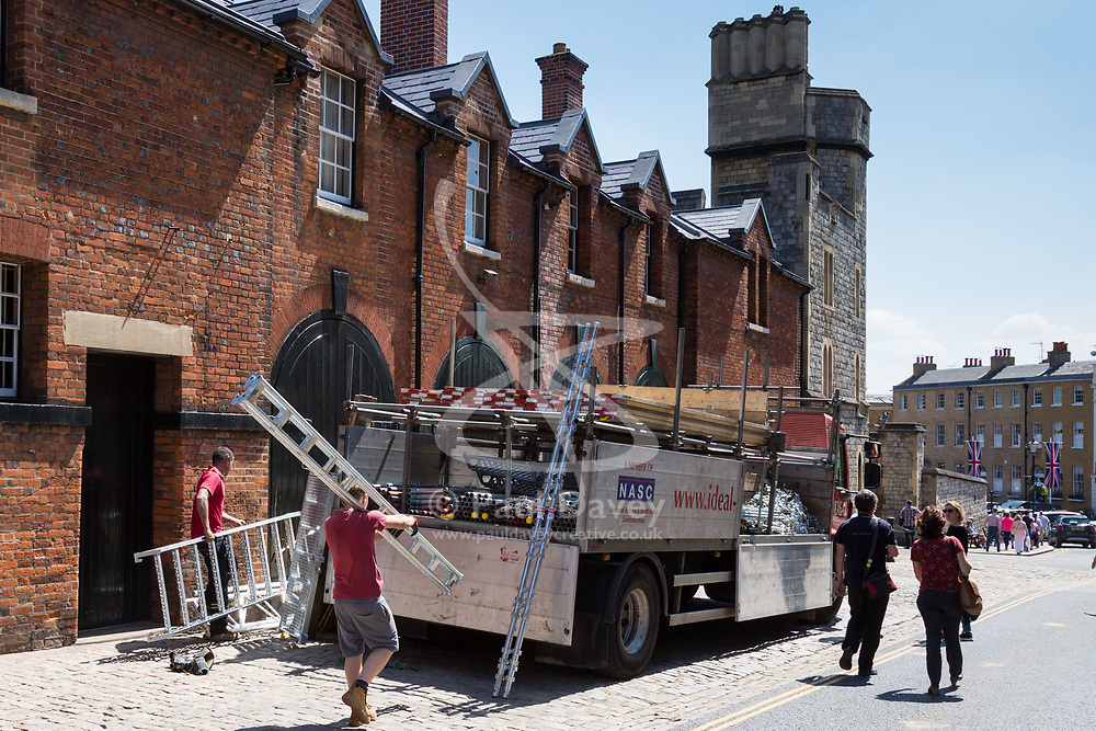 Workers load a truck with temporary structure components on the day following the wedding of Prince Harry to Meghan Markle in Windsor, Berkshire. WINDSOR, May 20 2018.