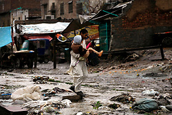 A man carries a child as he crosses a waterlogged street after heavy rain in northwest Pakistan's Peshawar, Feb. 25, 2015. At least two women were killed as a roof of a house collapsed in Peshawar. Heavy rains have wreaked havoc in different areas of Kashmir, Khyber Pakhtunkhwa and Gilgit-Baltistan on Wednesday, local media reported. EXPA Pictures © 2015, PhotoCredit: EXPA/ Photoshot/ Umar Qayyum<br /> <br /> *****ATTENTION - for AUT, SLO, CRO, SRB, BIH, MAZ only*****