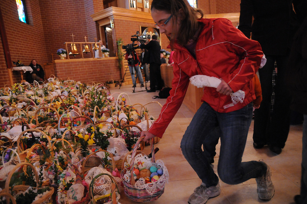 Another Easter Basket is added to more than one thousand to be blessed by Francis Cardinal George during a Holy Saturday Blessing of Easter Baskets at  Our Lady, Mother of the Church Polish Mission in Willow Springs.
