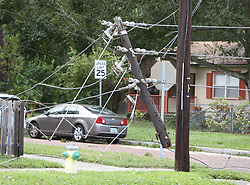 September 11, 2017 - St. Petersburg, Florida, U.S. - Duke Energy power poles have snapped at 30th Street South and 2nd Ave. South, St. Petersburg. Area closed off by St. Petersburg Police. (Credit Image: © Scott Keeler/Tampa Bay Times via ZUMA Wire)