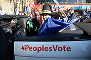Peoples Vote supporter as Jacob Rees Mogg does some back seat driving as Anti Brexit pro Europe demonstrators protest in Westminster opposite Parliament as MPs debate and vote on amendments to the withdrawal agreement plans on 14th February 2019 in London, England, United Kingdom.