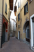 """Luino, Lombardia. ITALY.   """"Luino Old Town"""". Arch entrance to court yard and garage located in the  steep hilly narrow streets, on the side of Lake Maggiore, Province of Varese.. ITALY <br /> <br /> <br /> Monday  02/01/2017   <br /> <br /> © Peter SPURRIER,<br /> <br /> <br /> LEICA CAMERA AG LEICA Q (Typ 116). ISO 100  f1.7  28mm"""