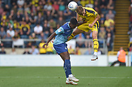 Oxford United defender (on loan from Everton) Luke Garbutt (3) heads the ball  under pressure from Wycombe Wanderers striker (on loan from Millwall) Fred Onyedinma (19) during the EFL Sky Bet League 1 match between Wycombe Wanderers and Oxford United at Adams Park, High Wycombe, England on 15 September 2018.