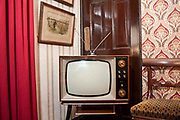 An old fashioned analogue television set in a home in the UK. These old TV models are nearly obsolete. British television has now moved to digital broadcasting, however you can keep your old television set by installing an adaptor that converts the digital signal into an analogue equivalent.