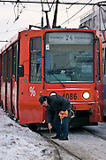 Moscow, Russia, 22/01/2006..A tram driver cears ice blocking the tram rails as a Siberian weather front brings temperatures down to minus 36C in the Russian capital and leads to power cuts in the city.