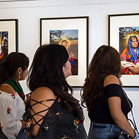 Art lovers come to see Hannah Manuelito's first art show of portraits of Navajo matriarchs at Art123 Gallery Saturday evening in Downtown Gallup.