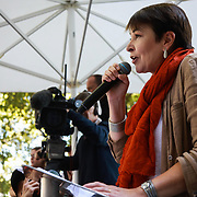 Tens of thousands took to the streets in Central London taking part in the the Global Climate Strike, September 20th 2019, London, United Kingdom.  Caroline Lucas from the Greenparty adresses the crowd. The day of strike for the climate was a global event with millions taking part across the globe. The strike was inspired by Greta Thunberg, a Swedish school girl who started the first school strike for the climate. Her action inspired school children across the world to go on strike demanding radical climate change policies to save their future. On September 20th adults aand children alike went out on strike to demand radical political change and climate justice. The day included speeches and a march through central London.