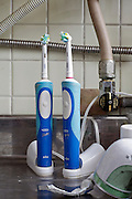 two electric toothbrushes on counter