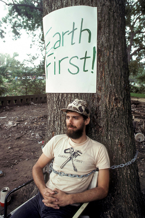 Texas: Man chained to tree to protest clear cutting of forest along stream. ©Bob Daemmrich /