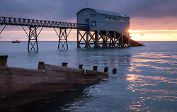 © Licensed to London News Pictures. 26/10/2016. Selsey, UK. Sunrise at Selsey Lifeboat Station this morning, 26th October 2016. The current station, re-built in 1958, currently houses the 'Betty and Thomas Moore' D-Class lifeboat. The station has a history of over 150 years of active lifeboat service. Photo credit: Rob Arnold/LNP