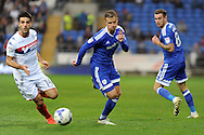 Cardiff City's Joe Bennett (c) chases the ball with Wigan's Jordi Gomez (l) watched on by Cardiff's Joe Ralls (r). EFL Skybet championship match, Cardiff city v Wigan Athletic at the Cardiff city stadium in Cardiff, South Wales on Saturday 29th October 2016.<br /> pic by Carl Robertson, Andrew Orchard sports photography.