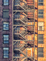 Building facade with fire escape stairs.