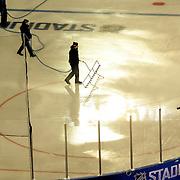 Stadium staff prepare the ice before the New York Rangers Vs New York Islanders  NHL regular season game held outdoors at Yankee Stadium, The Bronx, New York, USA. 29th January 2014. Photo Tim Clayton
