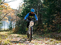 Alex Indeck grinds up the Rock Loop trail during the Fall Flurry mountain bike race at Gunstock on Saturday morning.  (Karen Bobotas/for the Laconia Daily Sun)
