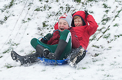 © Licensed to London News Pictures 10/02/2021.        Rochester, UK. Two boys Jasper age 9 (Back) and Rupert age 7 (Front) sledging in Rochester, Kent. (permission given by mum) Temperatures are set to drop to a freezing cold -7C in Kent and the South East tonight with more snowfall expected. Photo credit:Grant Falvey/LNP