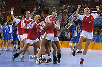 Denmark players celebrate their penalty throw shoot out victory. Denmark v Korea, Womens Handball Final, Athens Olympics, 29/08/2004. Credit: Colorsport / Matthew Impey DIGITAL FILE ONLY