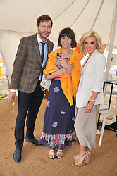 Left to right, CHRIS O'DOWD, DAWN PORTER and KATHERINE JENKINS at the 2012 Veuve Clicquot Gold Cup Final at Cowdray Park, Midhurst, West Sussex on 15th July 2012.