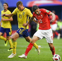 July 3, 2018 - Saint Petersburg, Russia - Viktor Claesson of Sweden fights for the ball with Ricardo Rodriguez of Switzerland during the 2018 FIFA World Cup Round of 16 match between Sweden and Switzerland at Sankt Petersburg Stadium in Sankt Petersburg, Russia on July 3, 2018  (Credit Image: © Andrew Surma/NurPhoto via ZUMA Press)