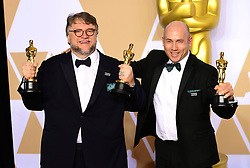 Guillermo Del Toro and J. Miles Dale with their Best Picture Oscar for The Shape of Water in the press room at the 90th Academy Awards held at the Dolby Theatre in Hollywood, Los Angeles, USA.PRESS ASSOCIATION Photo. Picture date: Sunday March 4, 2018. See PA Story SHOWBIZ Oscars. Photo credit should read: Ian West/PA Wire