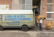 """Italy, Capannori, armchairs downloaded from the Daccapo Van. the blue writing says """" the van sucks but Daccapo is very cool"""" today there is Daccapo the reuse center where you can find useful and sustainable things"""