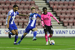 Siriki Dembele of Peterborough United takes on Matty Palmer and Curtis Tilt of Wigan Athletic - Mandatory by-line: Joe Dent/JMP - 20/10/2020 - FOOTBALL - DW Stadium - Wigan, England - Wigan Athletic v Peterborough United - Sky Bet League One