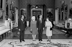 American President George Bush, his wife Barbara, Prince Philip and The Queen, in the Picture Room at Buckingham Palace.