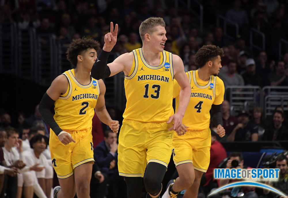 Michigan Wolverines forward Moritz Wagner (13) celebrates during a West Regional semifinal of the NCAA men's college basketball tournament against the Texas A&M Aggies, Thursday, March 22, 2018, in Los Angeles. Michigan defeated Texas A&M 99-72.
