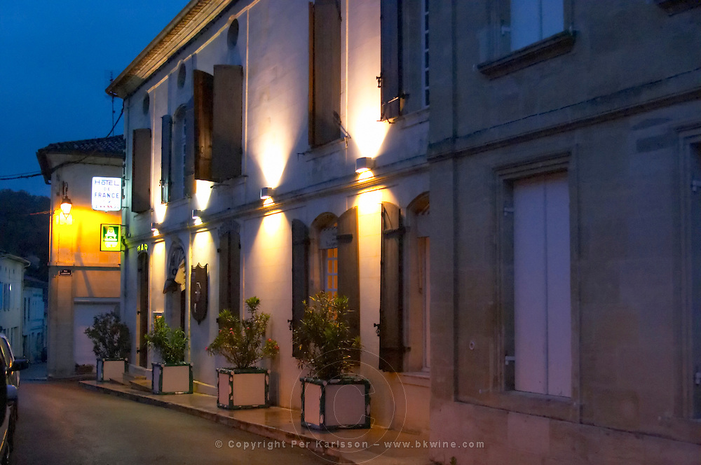 The Hotel de France country side town hotel at night with the facade lit by artificial light Entre-deux-Mers Bordeaux Gironde Aquitaine France