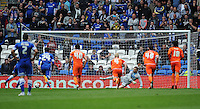 GOAL - Blackpool's Elliott Parish looks on helplessly as Cardiff City's Eoin Doyle (obscured) scores his sides third goal from the spot<br /> <br /> Photographer Kevin Barnes/CameraSport<br /> <br /> Football - The Football League Sky Bet Championship - Cardiff City v Blackpool - Saturday 25th April 2015 - Cardiff City Stadium - Cardiff<br /> <br /> © CameraSport - 43 Linden Ave. Countesthorpe. Leicester. England. LE8 5PG - Tel: +44 (0) 116 277 4147 - admin@camerasport.com - www.camerasport.com