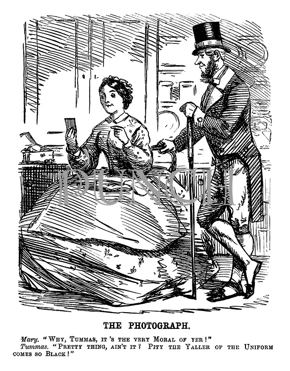 """The Photograph. Mary. """"Why, Tummas, it's the very moral of yer!"""" Tummas. """"Pretty thing, ain't it? Pity the yaller of the uniform comes so black!"""""""