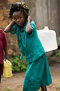 A girl carries a jerican full of water in Rutshuru, 70km north of Goma, Eastern Democratic Republic of Congo, on Thursday December 11, 2008..