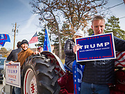 """09 NOVEMBER 2019 - DES MOINES, IOWA: Supporters of US President Donald Trump ride a tractor around a climate change town hall sponsored by Senator Bernie Sanders. About 20 Trump supporters protested the event.Sanders and Rep. Congresswoman Alexandria Ocasio-Cortez (D-NY), hosted the """"Climate Crisis Summit"""" at Drake University in Des Moines. More than 2,000 people attended the event. Sanders, an independent, is running to be the Democratic nominee for the 2020 US Presidential election. Iowa holds the first in the country selection contest with state caucuses on Feb. 3, 2020.              PHOTO BY JACK KURTZ"""