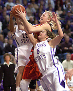 Iowa State's Megan Ronhovde (C) fights for a rebound with Kansas State's Shalee Lehning (5) and Twiggy McIntyre (15) in the first half at Bramlage Coliseum in Manhattan, Kansas, February 11, 2006.  The Wildcats lead the Cyclones at halftime 33-25.