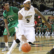 Central Florida guard Marcus Jordan (5) drives past Marshall center Nigel Spikes (11) during a Conference USA NCAA basketball game between the Marshall Thundering Herd and the Central Florida Knights at the UCF Arena on January 5, 2011 in Orlando, Florida. Central Florida won the game 65-58 and extended their record to 14-0.  (AP Photo/Alex Menendez)