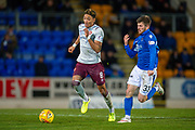 Sean Clare (#8) of Heart of Midlothian FC runs past Matthew Kennedy (#33) of St Johnstone FC during the Ladbrokes Scottish Premiership match between St Johnstone FC and Heart of Midlothian FC at McDiarmid Park, Perth, Scotland on 30 October 2019.