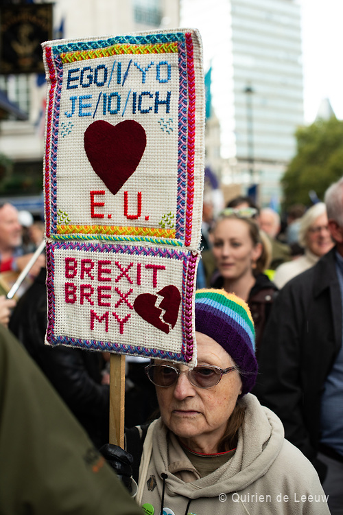 A demonstrator with a knitted protest board reads: Ego/I/Yo/Je/Io/Ich love EU. Brexit brakes my heart