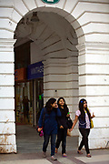 Teenage girls walk through Connaught Place, New Delhi.<br /> Connaught Place was designed as the central business district of New Delhi by British architect Edwin Lutyens and over the last two years has been revamped by the New Delhi Municipal Council (NDMC) as part of its 'Return to heritage Project'.