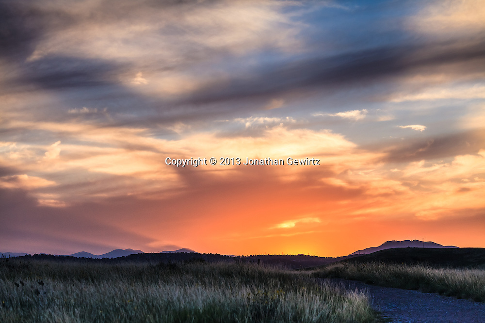 A spectacular sunset in the William F. Hayden Park on Green Mountain in Lakewood, Colorado. <br /> <br /> WATERMARKS WILL NOT APPEAR ON PRINTS OR LICENSED IMAGES.<br /> <br /> Licensing: https://tandemstock.com/assets/99720666