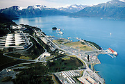 Alaska. Valdez. Aerial view . Oil tankers fill up at  the Alyeska Pipeline Terminal. Trans Alaska oil pipeline. Valdez Narrows, Prince William Sound.