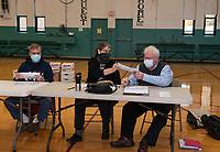 Wayne Eshelman, Carla Frisbee and Sam Brickley go through the ballot verification process for Ward 2 at the Laconia Community Center Thursday morning.  (Karen Bobotas Photo/for The Laconia Daily Sun)
