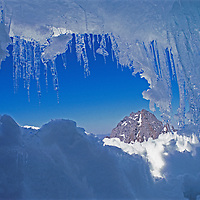 Icicles hang from a bergschrund crevasse in the Palisade Glacier in California's Sierra Nevada.  Mount Gayley is in the background.