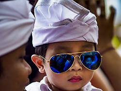 August 2, 2017 - Ubud, Bali, Indonesia - A boy in his father's arms waits to get into the temple during the ''Merchants' Day'' ceremony at the Pura (Temple) Melanting Pasar Ubud, the small Hindu temple in the Ubud market. It's a day that merchants throughout Ubud come to the temple to make offerings and pray for prosperity. (Credit Image: © Jack Kurtz via ZUMA Wire)