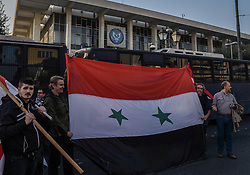 April 13, 2018 - Athens, Greece - Protests holds a Syrian flag outside the US Embassy in Athens, Friday, April 13, 2018, during a rally against possible western military intervention in Syria. (Credit Image: © Dimitris Lampropoulos/NurPhoto via ZUMA Press)