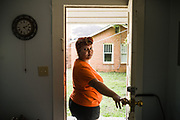 MONTGOMERY, AL – JUNE 11, 2019: Myra Powell, 21, stands in the apartment she rents with her fiancé, Stefvenie Buckner, in the Capitol Heights neighborhood. At age 19, while 26 weeks pregnant, Powell suffered a catastrophic placental abruption and was taken by ambulance to a nearby hospital. While there, doctors discovered her placenta had fully detached from the uterine wall, depriving her twin boys of oxygen. Silas and Stefvon died in utero. Narrowly escaping death herself, Powell would later be diagnosed with HELLP syndrome, a pregnancy-induced blood pressure condition in the eclampsia family that kills nearly a third of all women who develop it. As a young, poor, black woman from the south, Powell represents the deadliest cross-section of demographics among mothers in America, where more women die from pregnancy related causes than any other wealthy country in the world.