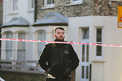 © Licensed to London News Pictures. 04/01/2020. London, UK. A police officer guards the crime scene on Charteris Road, near the junction with Lennox Road, Finsbury Park in north London. Police launch a murder investigation following a death of a man in his 30s on Friday 3 January 2020. Police were called at approximately 6.50pm to reports of a man stabbed and the he was pronounced dead at the scene just after 7.30pm.  Photo credit: Dinendra Haria/LNP